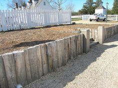 fence and wood retaining wall Retaining Wall Fence, Landscaping Retaining Walls, Landscaping Ideas, Westbury Gardens, Sloped Yard, Walled Garden, Beach Wood, Beach Gardens, Garden Inspiration