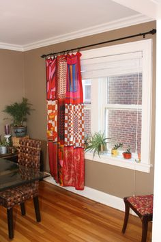 9 square silk scarves hand-stitched together to form a curtain...what a lovely effect!