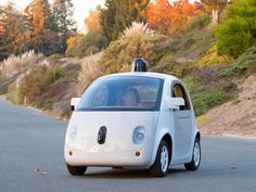 The company takes the wraps off a finished prototype as it forges ahead with plans to bring driverless cars to market.