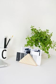 This minimal desk organizer by Bukatron is perfect for tidying things up.