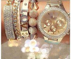 Bracelets and watch = Pulseras y reloj