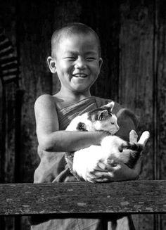 little monk cuddling a cat <3