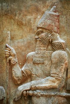 Stone relief sculptured panel of Saron II. Facade L. Inv AO 19873-4 from Dur Sharrukin the palace of Assyrian king Sargon II at Khorsabad, 713-706 BC. Louvre Museum Room 4 , Paris | Photos Gallery