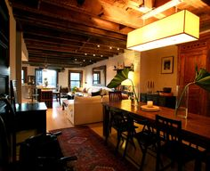 open dining room/living room/kitchen in a converted carriage house