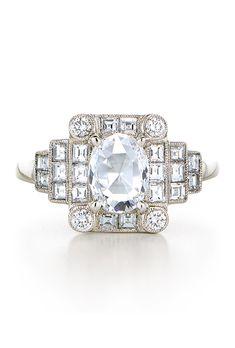 Brides.com: . 0.70 carat rose-cut oval diamond with square and round brilliant diamond accents in platinum, price upon request, Kwiat