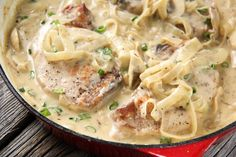 These Smothered Pork Chops are super easy to make, and the smell of them cooking will bring your family running to the table! Slow Cooker Recipes, Cooking Recipes, Skillet Recipes, Heavy Cream Recipes, Smothered Pork Chops Recipe, Pork Loin Chops, Pork Chop Recipes, Ham Recipes, Noodle Recipes