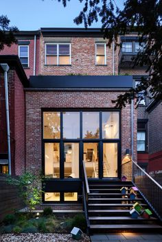 Located in Brooklyn, N.Y., this beautiful townhouse by Tamara Eaton Design features a brick exterior and stunning contemporary design. Photo By: Francis Dzikowski