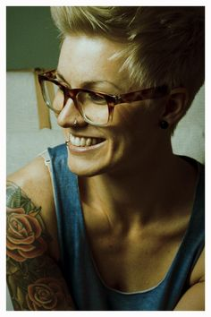 short hair, glasses, and tats