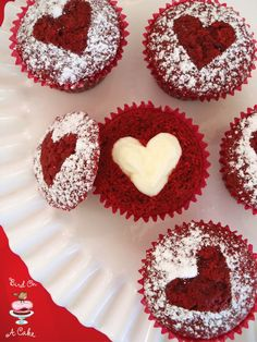 Hidden Heart Red Velvet Cupcakes...there is a frosting heart inside the cupcake! {Bird On A Cake}
