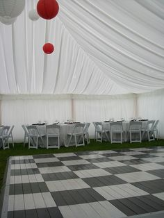 EFL Chequered Dance Floor - The Hive NZ - A buzzing online shopping experience. Real pine wooden dance floor - painted with poly coating 4mx4m with silver metal edging. Includes setting up and dismantling.  Offer excludes transport (40c per km) - offer only for North Island subject to availability so check with us first!!