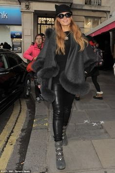Paris Hilton.. Sofia Cashmere Fox Fur Cape, Rag & Bone the Reverse Jodhpur Pants, Alaia booties, and Chanel Double C Pendant..