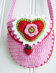 Pretty little purse with a strawberry dangle embellishment!
