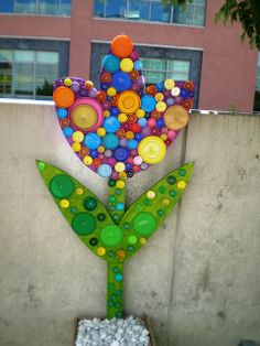 Reuse, Recover, Repurpose, Bottle Cap Bugs and Festive Flowers, Racine Art Museum, Racine, Wisconsin by hanneorla, via Flickr