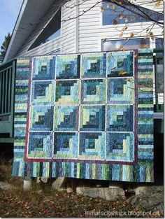Wildlife Themed Batik Log Cabin QUuilt - the centre squares each have a wild critter in them.