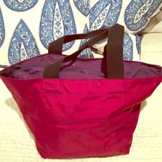 Herve Chapelier bag Burgundy color front and back. Eggplant color bottom and top with zipper. Smaller size. Good for daytime. Overall really decent condition. Herve Chapelier Bags