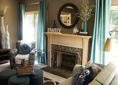 An inviting taupe and turquoise living room featuring fun patterns and textureswith fireplace by Lindsay Hoekstra West Michigan interior designer.