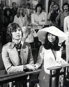 Mick & Bianca Jagger. St. Tropez. Marriage. Is that Jim Morrison in the back?