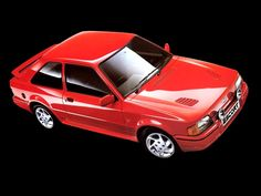 My 12th Car: Ford Escort RS Turbo. In White. Took this car to NL when I lived in Amsterdam. Fantastic little car.