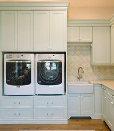 Beautiful Laundry Room - washer and dryer set up high, lots of storage, pretty tile backsplash, cabinets are Benjamin Moore Hollingsworth Green HC-141, walls are Sea Pearl OC-20