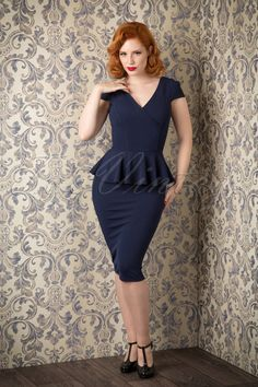 You can create the most stunning looks with this gorgeous50s Genevieve Peplum Dress in Navy Crêpeby Vintage Chic!Planning a party and you have nothing to wear? TopVintage to the rescue: With this beauty you're good to go!The fitted style features a V-neck at the front and back, a playful wrap over, short cap sleeves and a flattering peplum waist to hide any tummy flaws and give you a beautiful curvy silhouette at the same time! The skirt emphasizes your curves even mo...