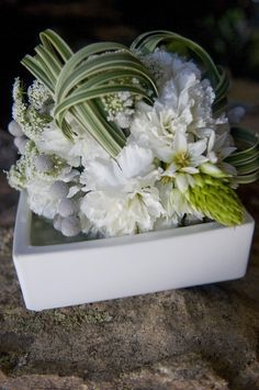 groupings of white flowers with variegated lily grass