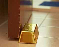 What does Donald Trump do when the office gets too stuffy? Surely the only logical solution is to hold the door open with a gold bar? The Gold Bullion Door Stop is a weighty door stop in the shape of a metallic gold bullion bar!