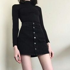 Black long sleeved shirt with black button front skirt