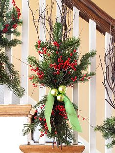 Dress up a banister by tying garland, berries, and twigs to it. See more small-space holiday decorating ideas: http://www.bhg.com/christmas/decorating/holiday-decorating-ideas-small-spaces/#page=5