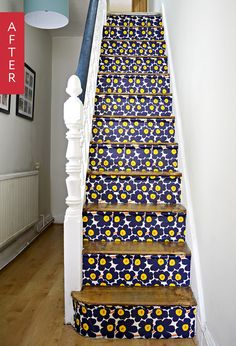 The raisers of this homeowners hallway stairs were given a new lease of life with the help of the Marimekko Unikko wallpaper. The Unikko print is their most famous and was originally designed in