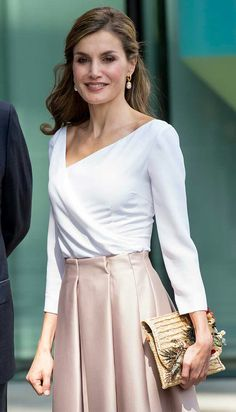 Letizia - satin midi skirt in a chic champagne colourway by Topshop - white surplice neck blouse - straw clutch by Suma Cruz