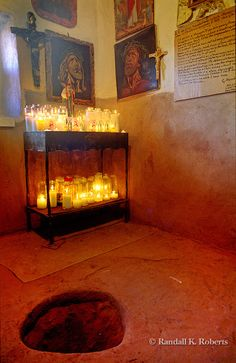Anteroom in Santurio de Chimayo with hole in the floor said to contain dirt that conveys miraculous healing power.  I have some if this dirt in a container.  Absolutely live this church <3
