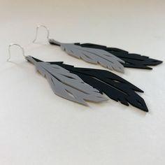 http://www.coruu.fi/product/292/double-feather-korvakorut-musta--harmaa
