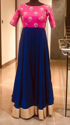 Beautiful pink and royal blue color combination floor length anarkali dress with hand embroidery thread work on yoke. Ready to ship.Price : 5000 INRTo order whatsapp 7013728388 . 25 July 2018