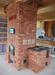 Masonry cookstove alongside a masonry heater with oven. Cookstove has a cast iron cooktop. Step by step how-to: pyromasse.ca