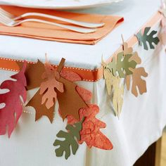 Table Garland  Turn an ordinary white tablecloth into a fall sensation. Center the tablecloth on your table. Just below the top edge of the table, hot-glue or pin grosgrain ribbon onto the tablecloth. From fall-color cardstock and decorative paper, trace various leaves; cut out. Glue them in clusters to the ribbon. Glue just the centers of the leaves so the edges curl up naturally