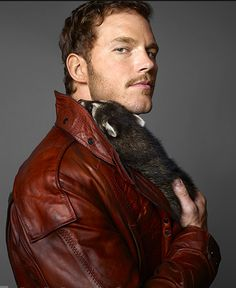 """Chris Pratt with a raccoon. Can I get a resounding """"awwwwwwww!"""". So cute (both of them, of course)."""