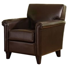 Add a classic touch to your living room or library with this handsome leather arm chair, featuring rolled arms and a traditional silhouette....
