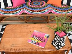 DIY outdoor cushions made with colorful beach towels.
