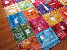 How do you make a slab?Take two pieces of fabric and sew them together. Do that a few more times. Then start sewing more pieces to those first pairs. Sew groups together. Add additional pieces of fabric as necessary to get up to your finished size. Start with small bits or big ones, it doesn't matter. Raid your scrap bins and go with what you've got.