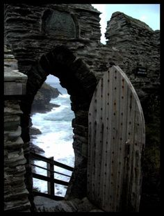 Dreamy old door in a natural setting. Looks like it could have been the door to an Abbey or a castle ruin.