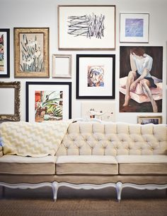 love that sofa, and the modern art gallery wall.