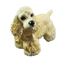 Blonde American Cocker Sapniel Dog Figurine is so realistic looking that you would like to reach down and pet it.