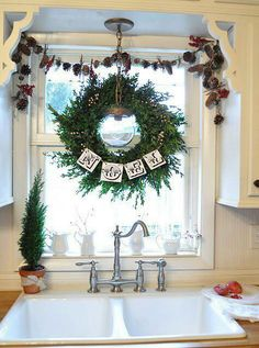 Christmas kitchen decor - a wreath over the sink!? I AM SO DOING THIS! #CHristmas #DeltaFaucetInspired