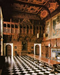 Marble Hall in Hatfield House, with its extravagant oak carving by John Bucke,  remains much as Robert Cecil, the 1st Earl of Salisbury, built it in 1611. Hertfordshire, England