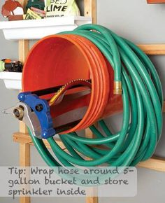 Handy Hose Storage by repurposing an old bucket, simply screw a 5 gallon pail to a wall stud and wrap garden hose around the bucket, store the sprinkler or sprayers inside the bucket.