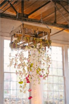 gorgeous floral chandelier hanging from a wooden crate