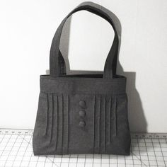 Hey, I found this really awesome Etsy listing at https://www.etsy.com/listing/90223995/pintuck-purse-with-buttons-in-dark-gray