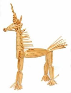A 'tied straw' corn dolly in the form of a unicorn. The body is tired and the horn is spirally woven. (MERL/86/78/1)