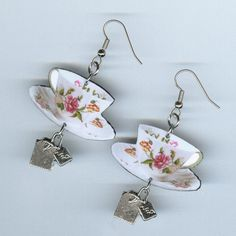 TEA TIME EARRINGS~~  How about a cup of tea? Ill have mine with cream and sugar.   Laminated tea cup and saucer images are layered with