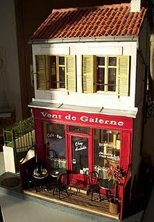 miniature dollhouse - I like the exterior - store on the bottom